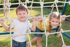 Happy children playing on the playground Stock Photos