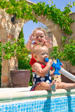 Happy children playing in the pool Royalty Free Stock Image