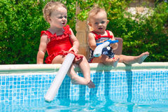 Happy children playing in the pool Royalty Free Stock Images