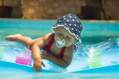 Happy children playing in the pool stock photo
