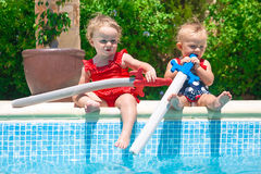 Happy children playing in the pool Royalty Free Stock Photo