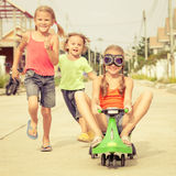 Happy children playing on the road Stock Photography