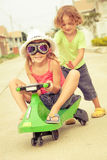 Happy children playing on the road Stock Images