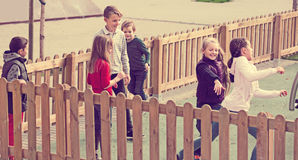 Happy children playing romp game Touch-last Royalty Free Stock Photography