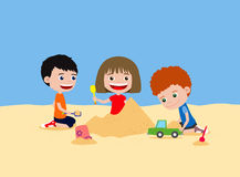 Happy children playing with sand. Building sand castle in the beach or playground. Royalty Free Stock Photos