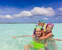 Happy children playing in sea Stock Images