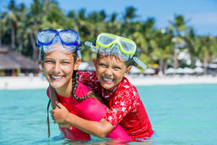 Happy children playing in the sea. Kids having fun outdoors. Summer vacation and healthy lifestyle concept Royalty Free Stock Image