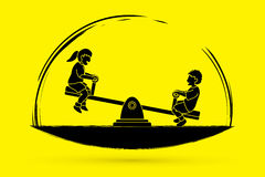 Happy Children are playing seesaw together Stock Photos