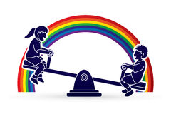 Happy Children are playing seesaw together Stock Images