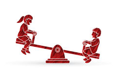Happy Children are playing seesaw together Royalty Free Stock Photography