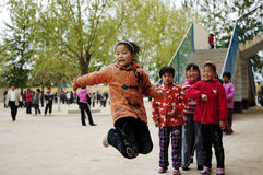 Happy children playing with skipping Royalty Free Stock Image