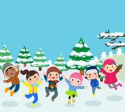 Happy children playing in snow Royalty Free Stock Images