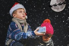 Happy children playing with snowflakes on winter walk. Happy Christmas holidays royalty free stock photo