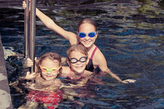Happy children  playing on the swimming pool Stock Photos