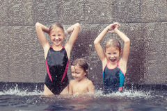 Happy children  playing on the swimming pool Stock Image