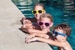 Happy children  playing on the swimming pool at the day time Royalty Free Stock Photo