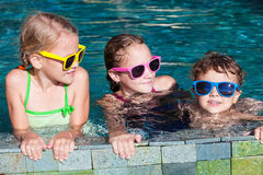 Happy children  playing on the swimming pool at the day time Stock Photos