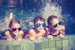 Happy children  playing on the swimming pool at the day time Stock Images