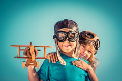Happy children playing with toy airplane Stock Image