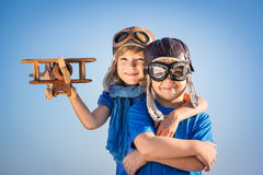 Happy children playing with toy airplane royalty free stock photos