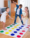 Happy children playing at twister Royalty Free Stock Images