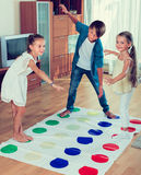Happy children playing at twister Stock Photography