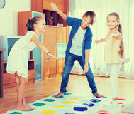 Happy children playing at twister Royalty Free Stock Image