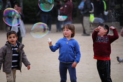 Free Happy Children Playing With Soap Bubbles Stock Images - 90994484