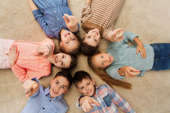 Happy children pointing finger to you Stock Photography