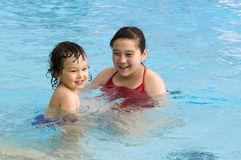 Happy children in pool. Royalty Free Stock Image