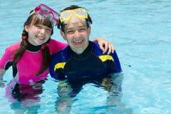 Happy children in pool Royalty Free Stock Photos
