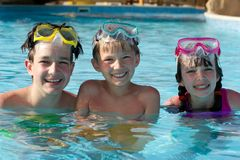 Happy children in pool Stock Photo