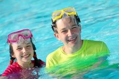 Happy children in pool Stock Images