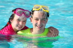 Happy children in pool Royalty Free Stock Image