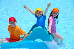 Happy children in pool Royalty Free Stock Photo