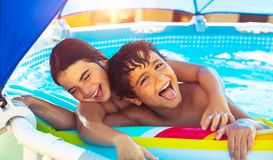 Happy children in the pool stock image