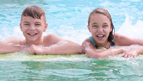 Happy children in pool stock footage