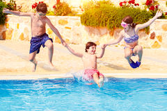 Happy children in the pool Stock Images