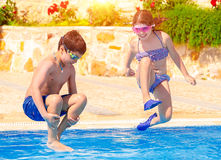 Happy children in the pool royalty free stock image