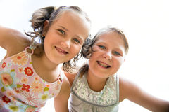 Happy children. Portrait of two small happy  smiling children from bellow Stock Photo