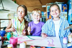 Happy Children Posing in Art Class royalty free stock photo
