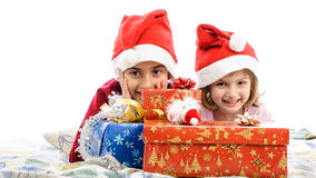 Happy children with presents gifts in bed Stock Image
