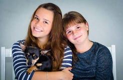 Happy children with puppy dog Stock Photos