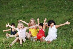 Happy children raising hands Stock Photos