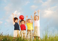Happy children raising hands Stock Image