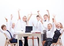 The happy children raising hands Stock Images
