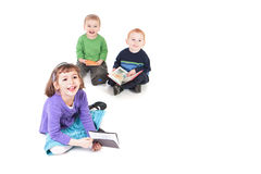 Happy children reading kids books royalty free stock photos