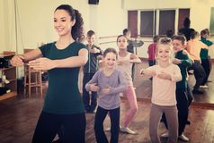 Happy children rehearsing ballet dance in studio Royalty Free Stock Photos