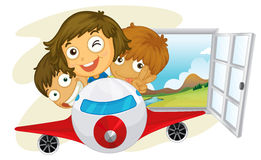 Happy children riding on a jetplane Royalty Free Stock Image