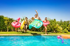 Happy children running and jumping into the pool royalty free stock photography